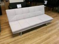 Cream fabric sofabed with metal legs
