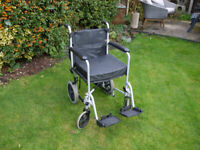 folding wheel chair with cushion & shopping bag fits into most small cars