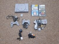 Playstation 1 with 4 games 2 controllers and gun all leads
