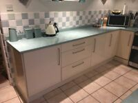 Cream high gloss kitchen units, work surface and sink - 4 years old - buyer dismantles