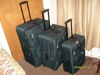 Three nesting suitcases