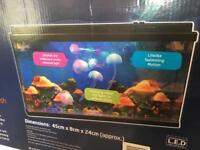 Brandnew Jellyfish Aquarium with Colour Changing LED 7 Fish,costs £89.95, bargain at £45