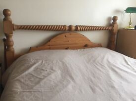 Antique pine kingsize bed with matching barley twist bedside cabinets.