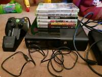 Xbox 360 E console 500GB, 6 games, 1 official wireless controller and venom charger stand.