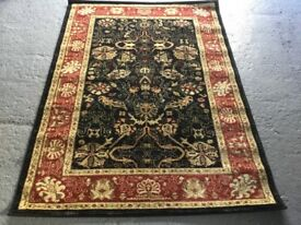 Rust/Black Wool Floor Rug. 170x120cm