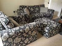 Black and cream floral printed sofas and a footstool (Free 3 cushions and rug)