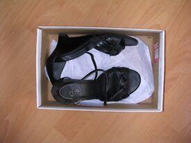 Soft black leather wedge heels size 5.5