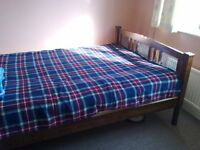 double bed of solid wood with resistant mattress