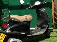 A good example of the Vespa LX50 with original extras of luggage rack and windscreen. Current MOT