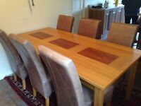 Solid wood dining table and eight leather chairs