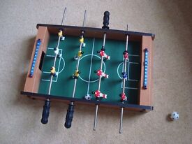 Marks and Spencer table top football £20 Sits on top of any surface and is very portable.