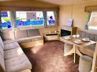 Cheap modern 6 berth caravan with no fees until 2020! Central heated!