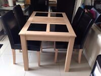 Stylish dining wooden table with 4 leather chairs