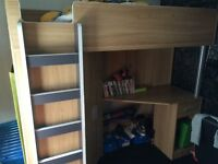 High sleeper bed with storage , it has a built in wardrobe with shelves . Excellent condition .