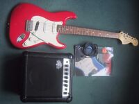 Fender Squire Strat` Electric guitar, amplifier and accesories
