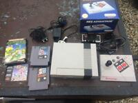 Nintendo NES 1985 with games and advantage pad
