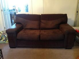 2 x 2 seater sofas one is a bed settee and a swivel love seat in reasonable condition