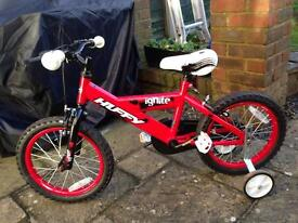 Children's red and white huffy ignite bike