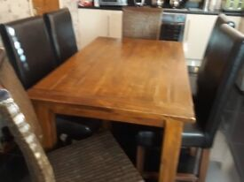 6 chairs 1table 4leather high back 2 wicker high back