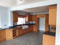 Solid oak kitchen door and cabinets