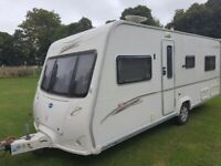 Bailey Senator Indiana 4 berth fixed bed caravan with fitted alarm and full awning