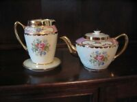 As purchased by Her Majesty Queen Mary Tea pot and hot water pot set with stand.
