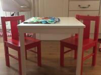 Kids Ikea table x2 red chairs