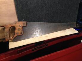 Diston crosscut saw.