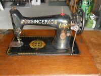 Singer Treadle Sewing Machine, 66K, cira 1917, with original instruction book and box of spare parts