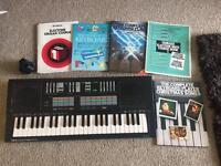 Yamaha keyboard and music books