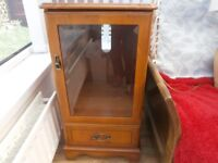 McDonagh small free standing unit with glass door and bottom drawer on castors