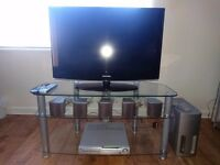 TV, DVD player + speakers + glass stand