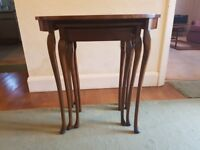 Three antique stacking dining room tables