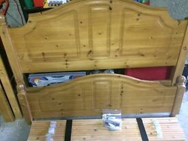 Double Bed. Solid wood. Head board and foot board bed with wooden slats. Good condition.