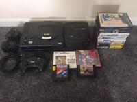 sega megadrive and mega cd console with games