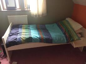 Single bed with shelves and cupboards under plus mattress