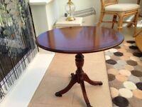 Oval mahogany table