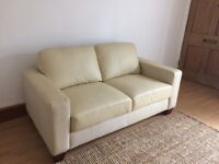 Nearly new 2 seater cream leather sofa