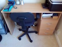 Sturdy desk, with 3 drawers. Comes with swivel chair