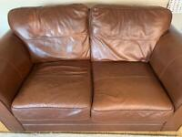 two brown large leather sofas