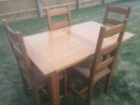 Light Oak Table and Four Chairs