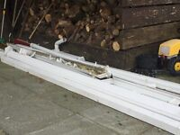 White guttering and downpipes