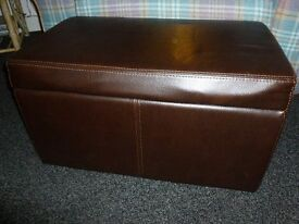 Real leather brown storage/ottoman. Faux leather mirror. Faux leather shelves.