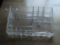desk tidy(brand new) in clear perspex sizes h 8cm...d 21cm...l 33cm,still in original packaging