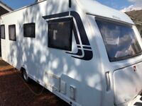 Lunar Venus 500/4, 2013 4 berth Caravan with fixed twin beds, motor mover, alarm and awning