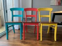 Three wooden chairs.