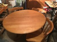 Round wooden table and 3 chairs
