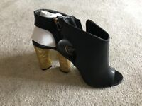 Brand New open toe and heel ankle boots size 4