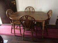 Wooden dining table comes with 4 chairs