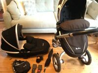 Silver Cross Surf 2. Fab condition. Carrycot. Rain over. Seat. Extras! Black